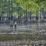 Fishing in the River Photo by Randy Sander